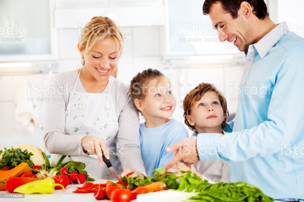 Happy family preparing a healthy dinner at home. royalty-free stock photo