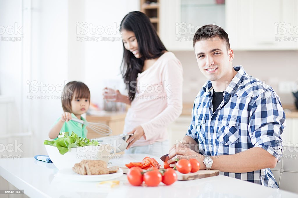 Happy Family Preparing Meal royalty-free stock photo