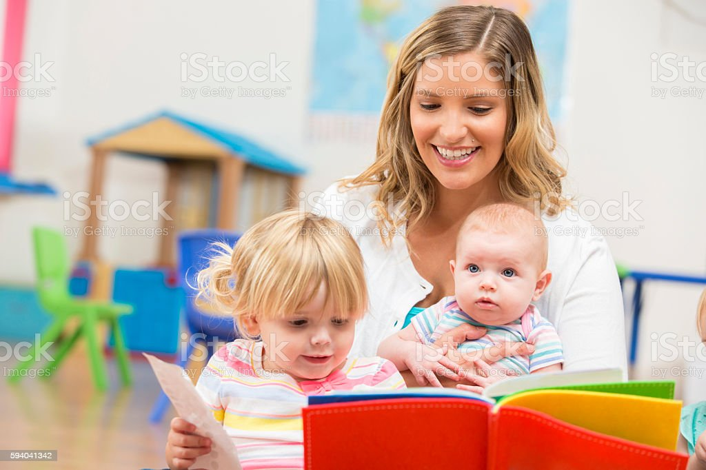 Happy family reading a book together stock photo