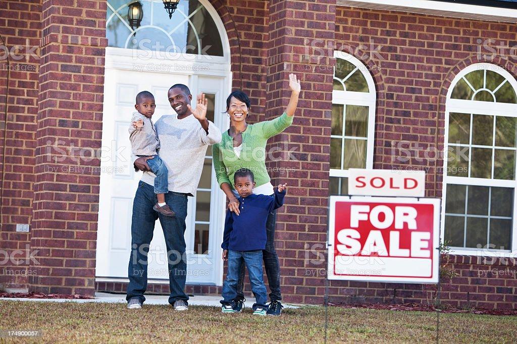 Happy family relocating stock photo
