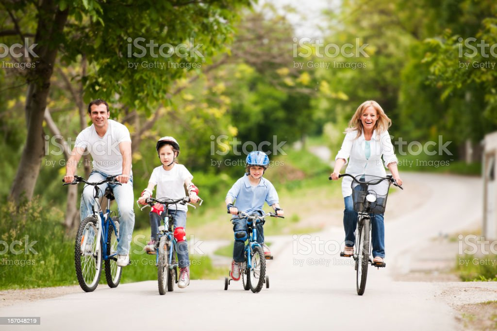 Happy family riding bicycle. royalty-free stock photo