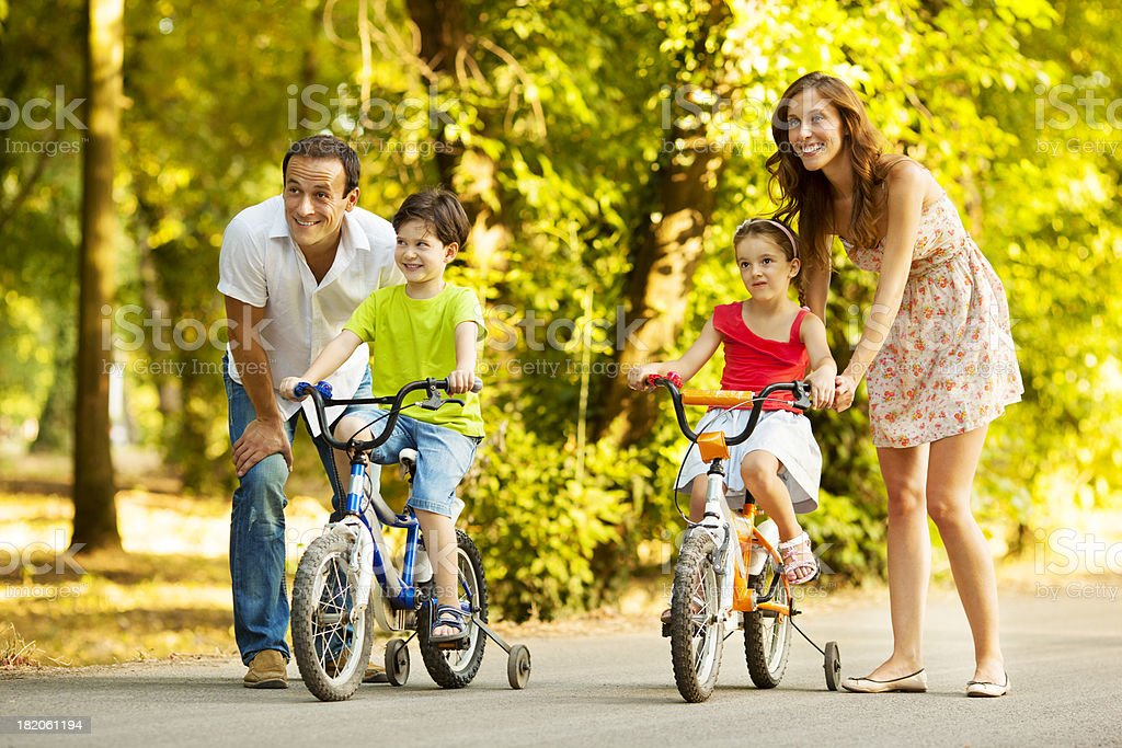Happy Family Riding Bicycles Outdoors royalty-free stock photo