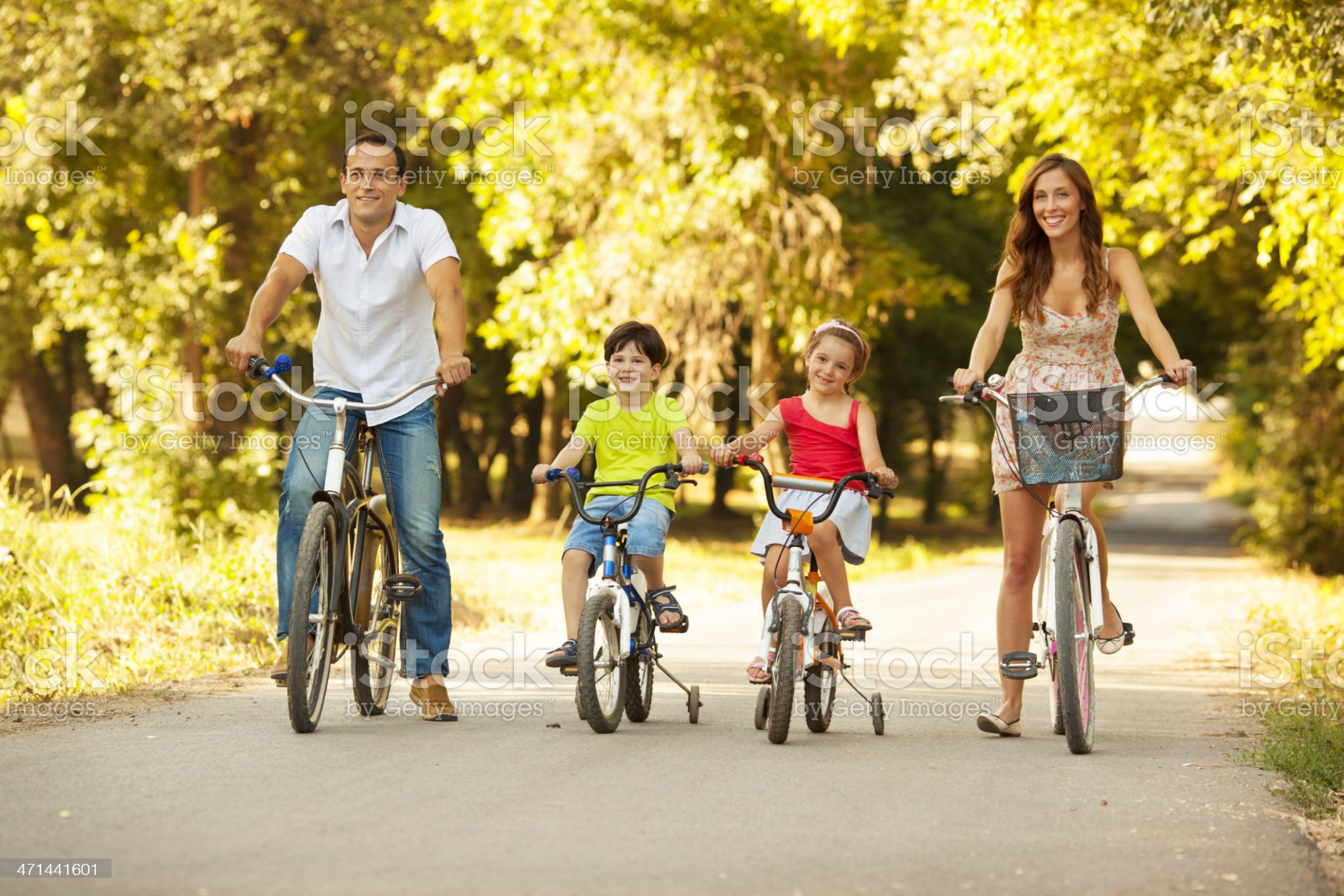 Happy Family Riding Bicycles Outdoors. royalty-free stock photo