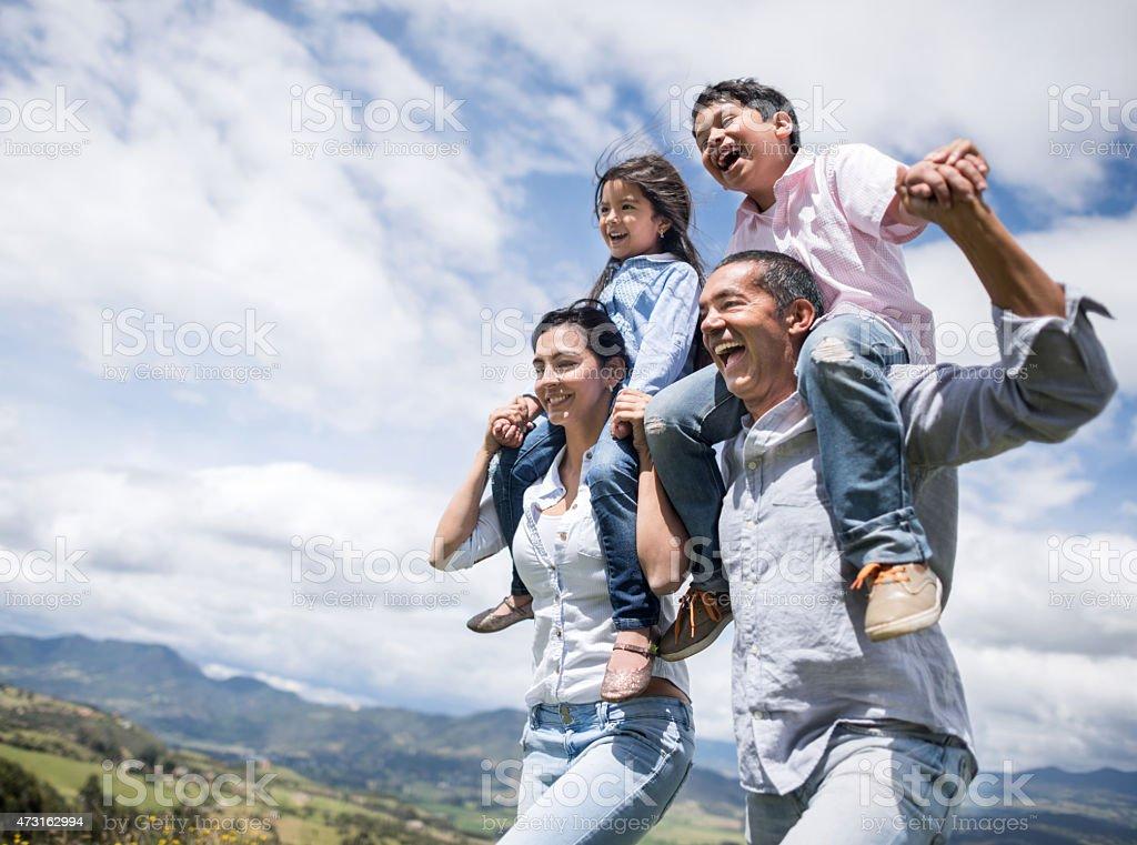 Happy family running outdoors stock photo