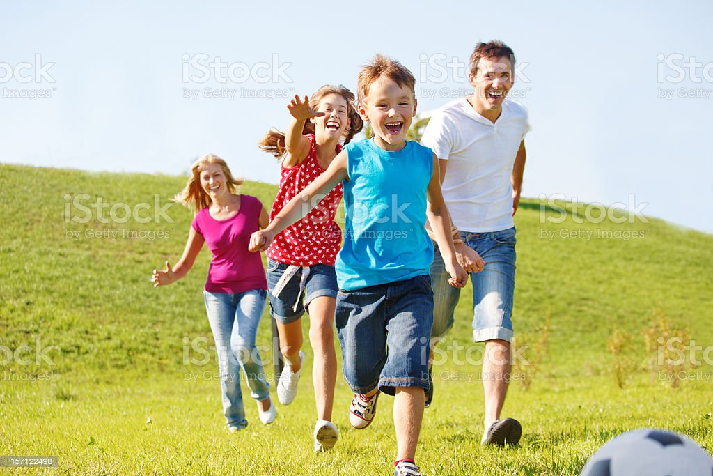 Happy family running royalty-free stock photo