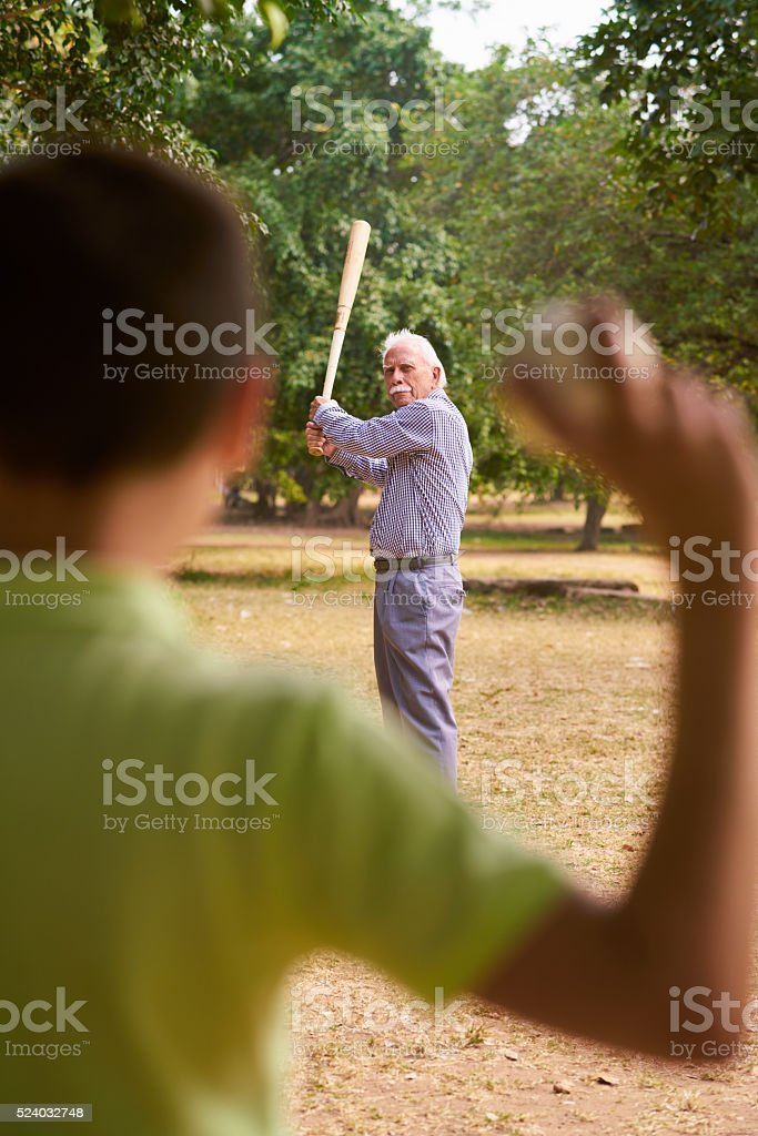 Happy Family Senior Grandpa and Grandson Boy Playing Baseball stock photo