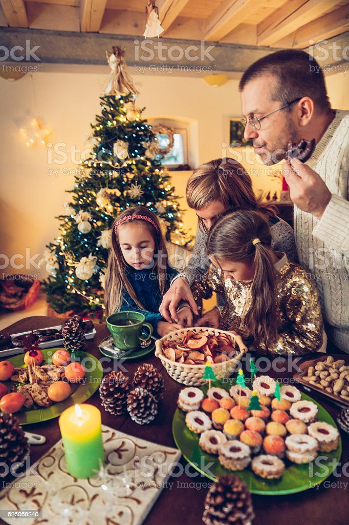Happy Family Sitting at the table after the Christmas Dinner stock photo