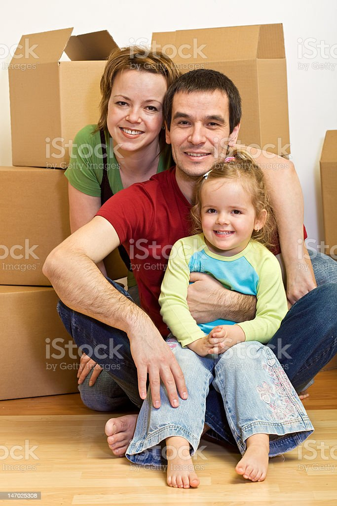Happy family sitting in on the floor royalty-free stock photo