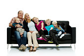 Happy family sitting on couch together