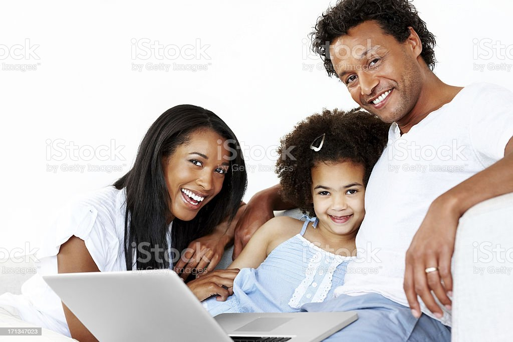 Happy family sitting on sofa with laptop royalty-free stock photo