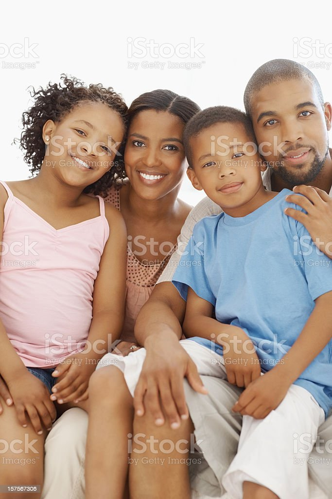 Happy family sitting together at home royalty-free stock photo