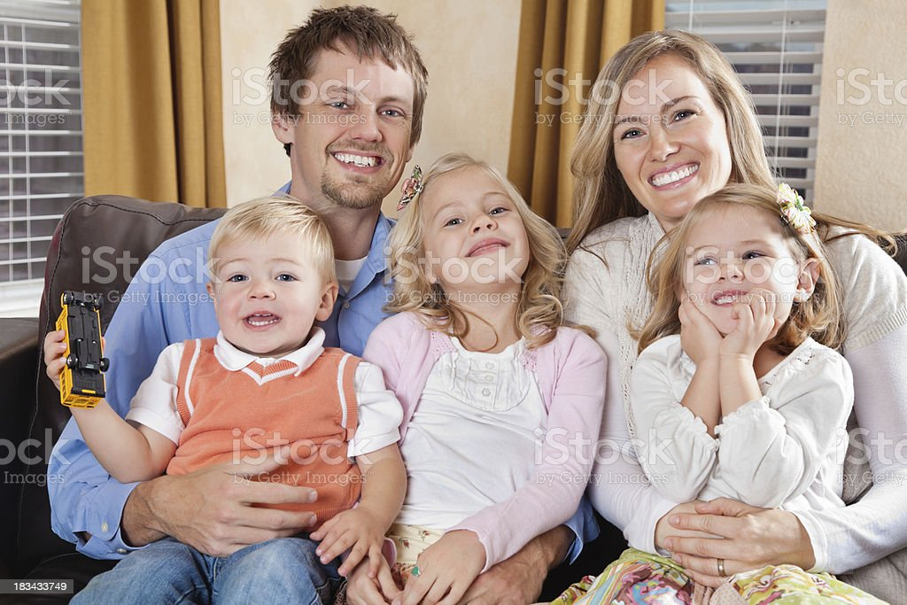 Happy Family Sitting Together in Living Room royalty-free stock photo