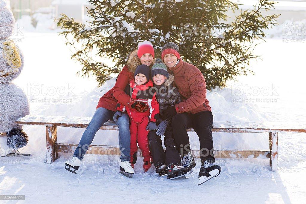 Happy family skate in the winter stock photo