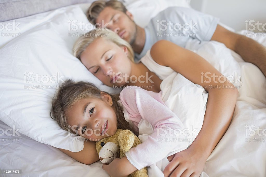 Happy family sleeping together royalty-free stock photo