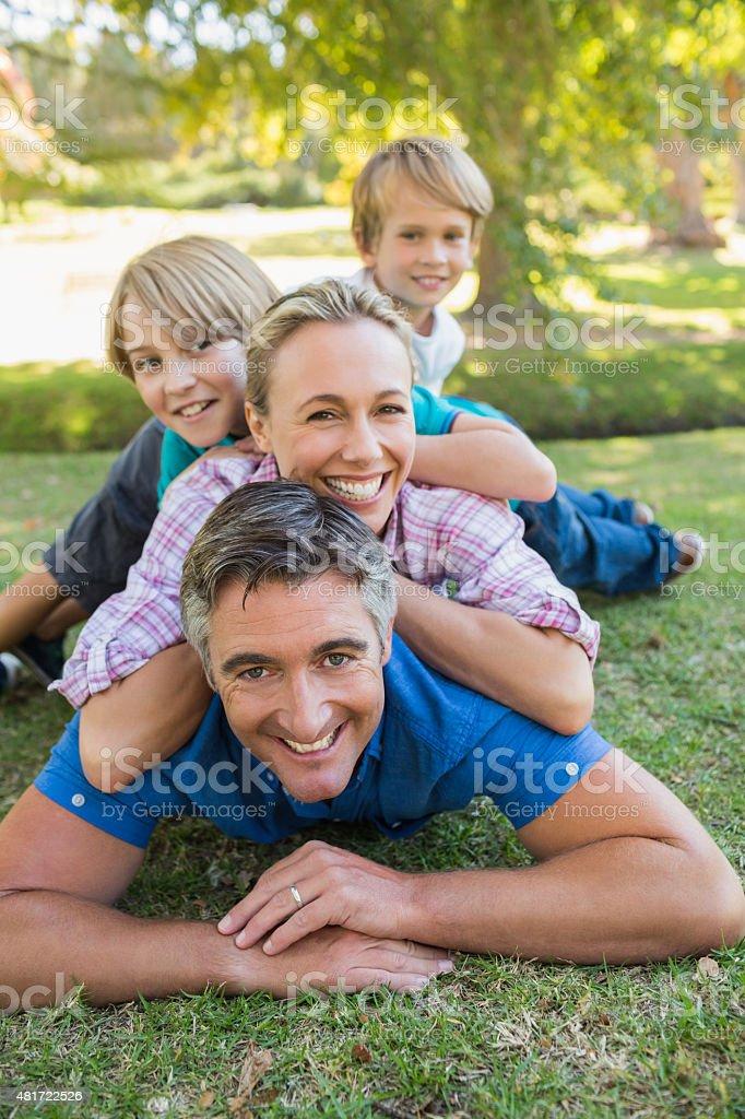 Happy family smiling at the camera stock photo