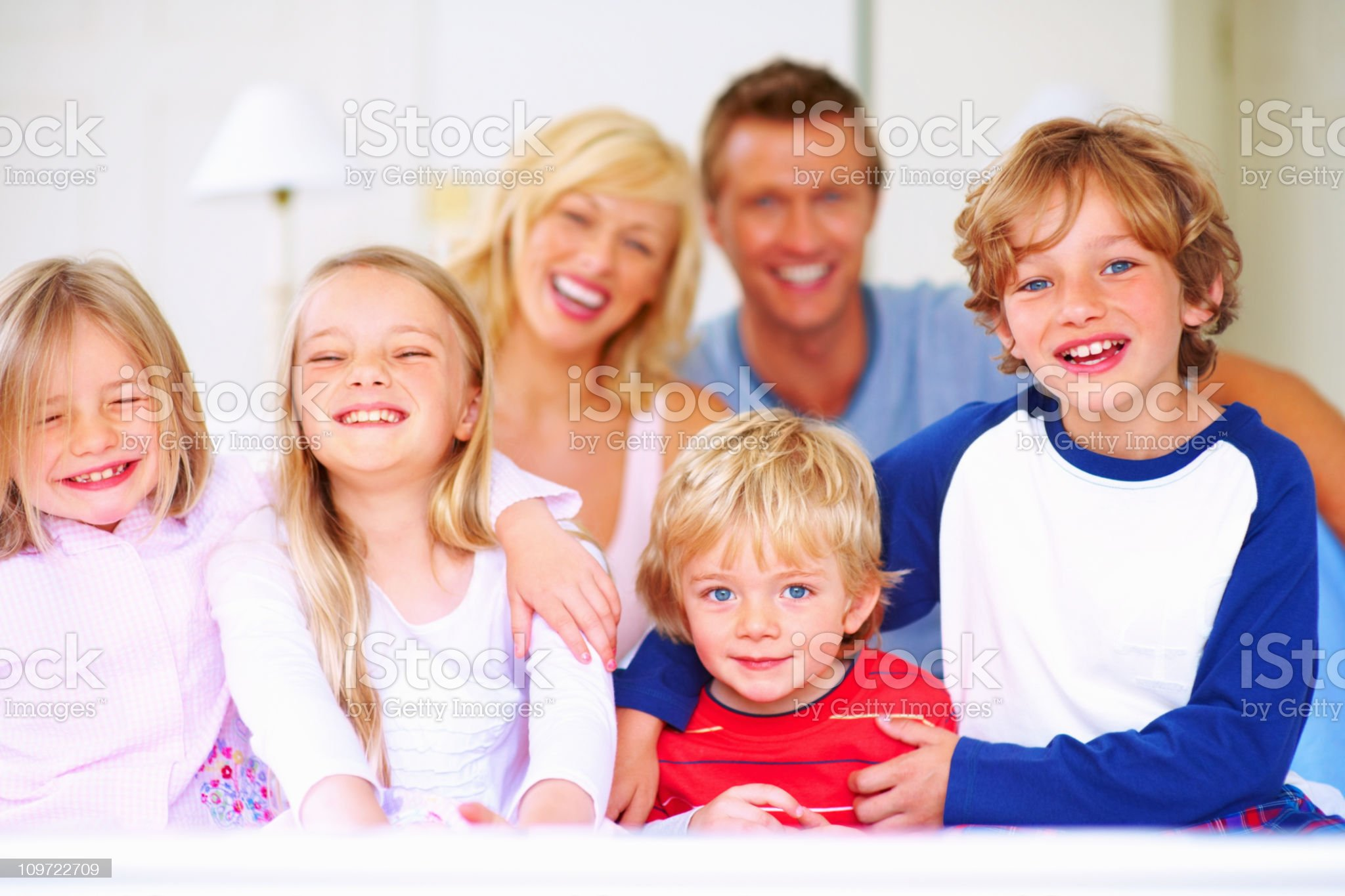 Happy family - Smiling middle aged couple with their children royalty-free stock photo