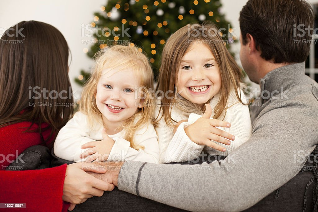 Happy Family Smiling Together at Home with Christmas Tree royalty-free stock photo