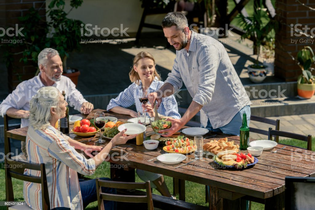 happy family spending time together on picnic outdoors stock photo