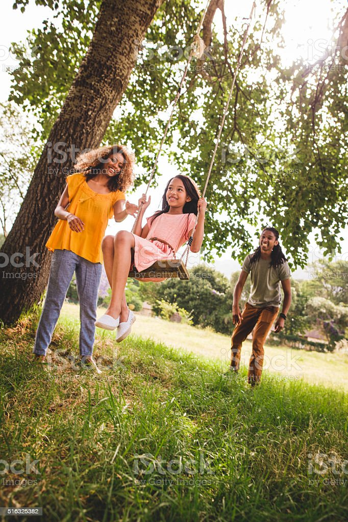 Happy family spends time outdoors for the weekend. stock photo