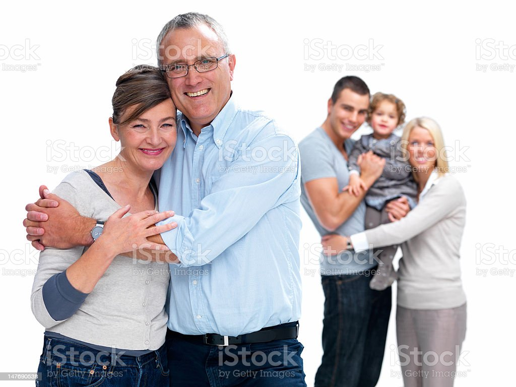 Happy family standing against white background royalty-free stock photo