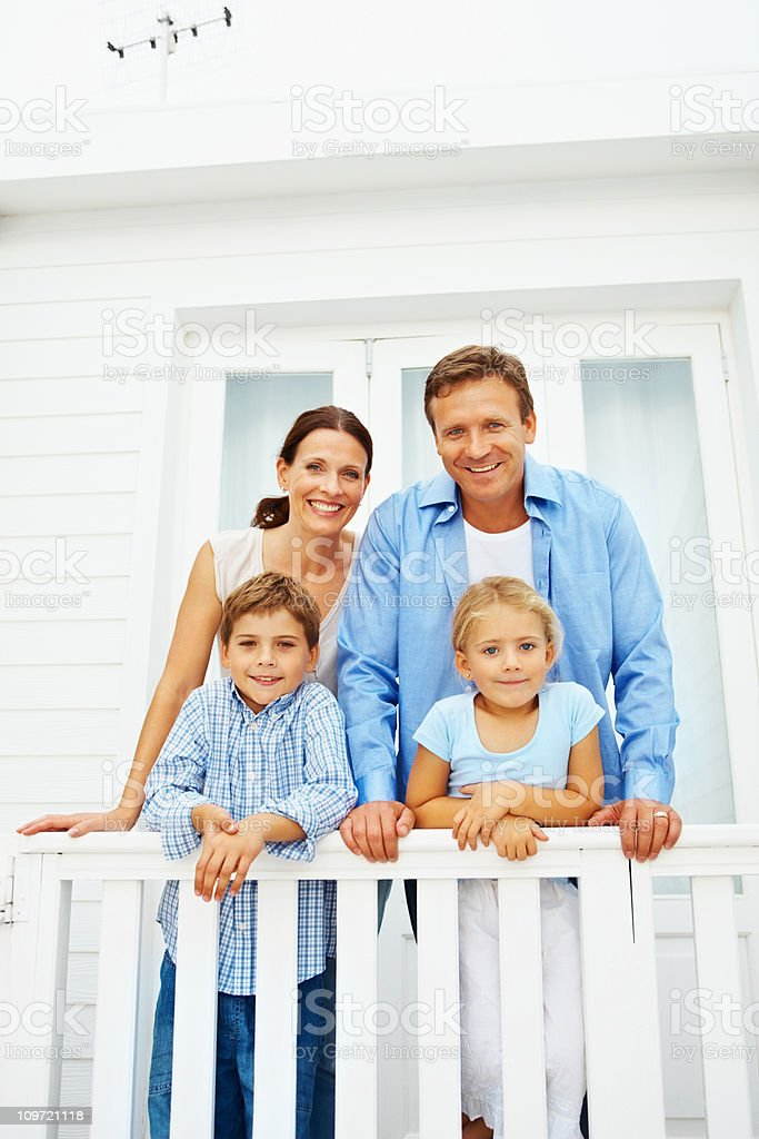 Happy family standing at the balcony royalty-free stock photo