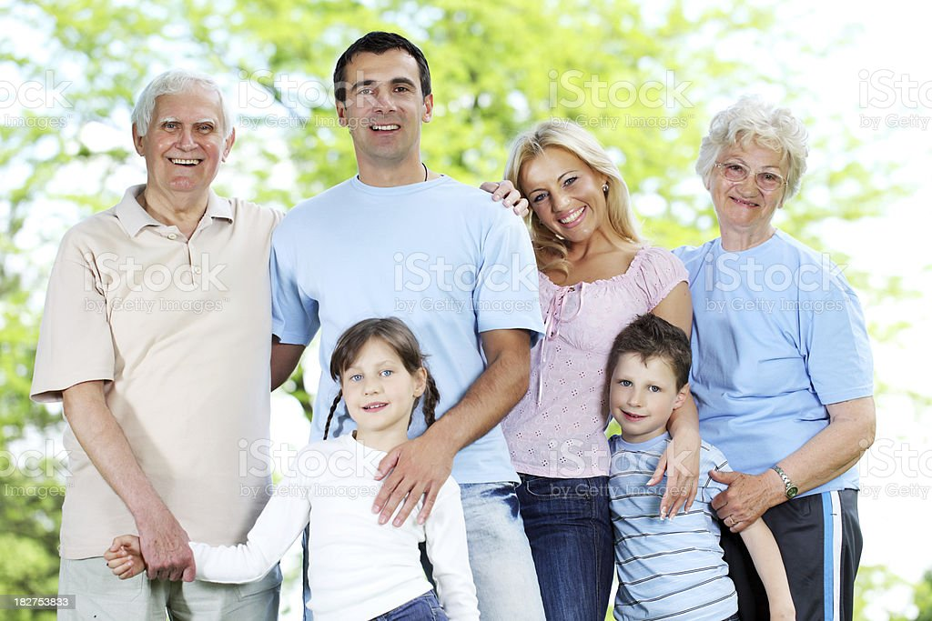 Happy family standing in the park. royalty-free stock photo