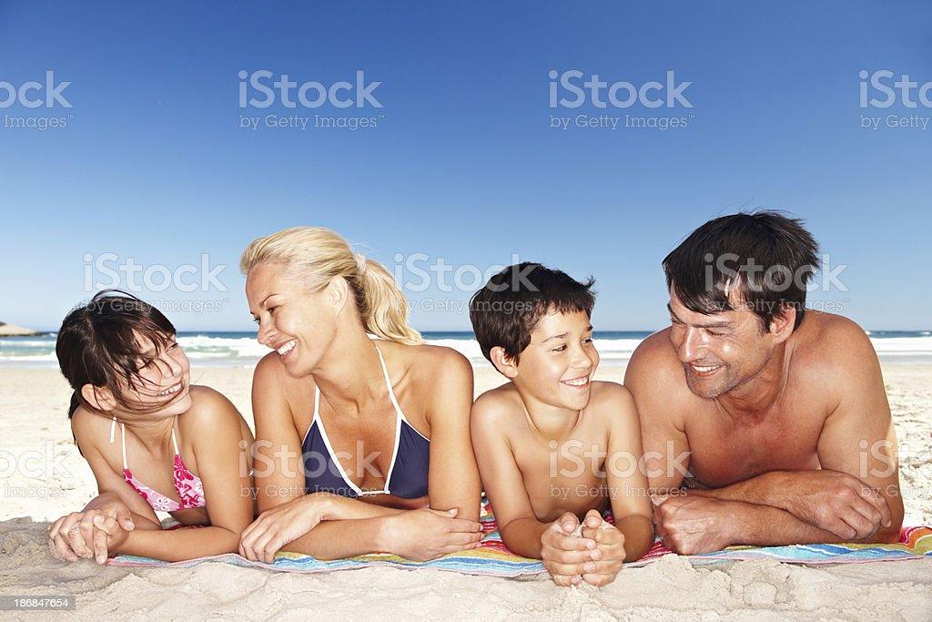 Happy family sunbathing royalty-free stock photo