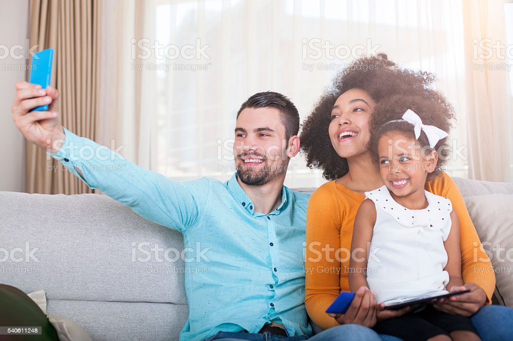 Happy family take a selfie with smart phone stock photo