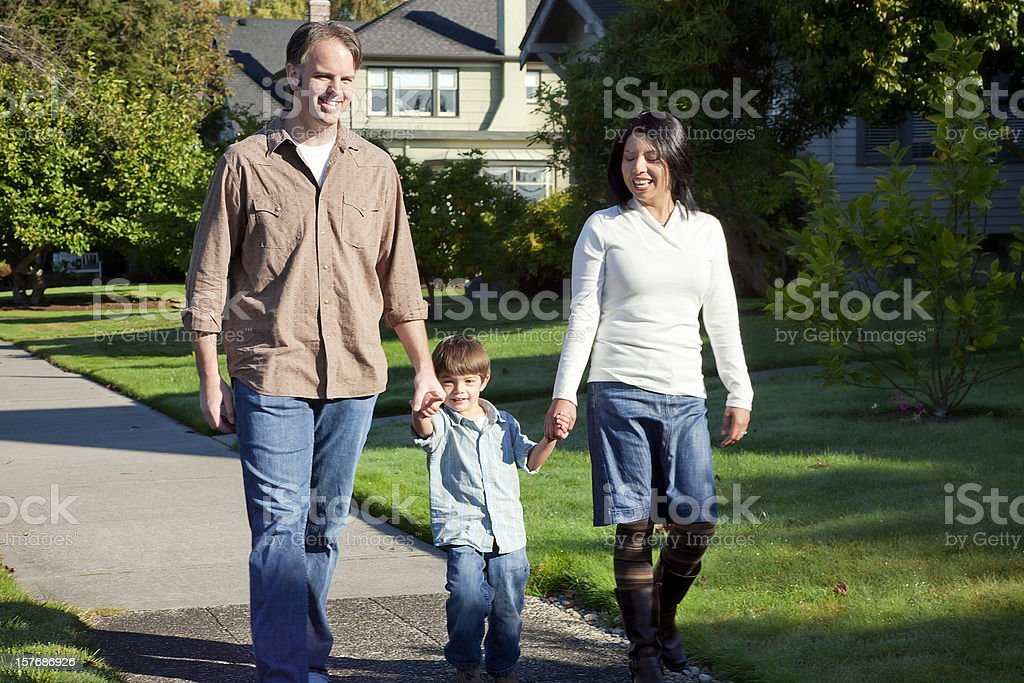 Happy Family Taking a Stroll royalty-free stock photo