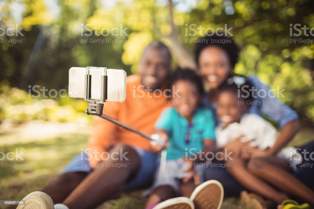Happy family taking picture stock photo