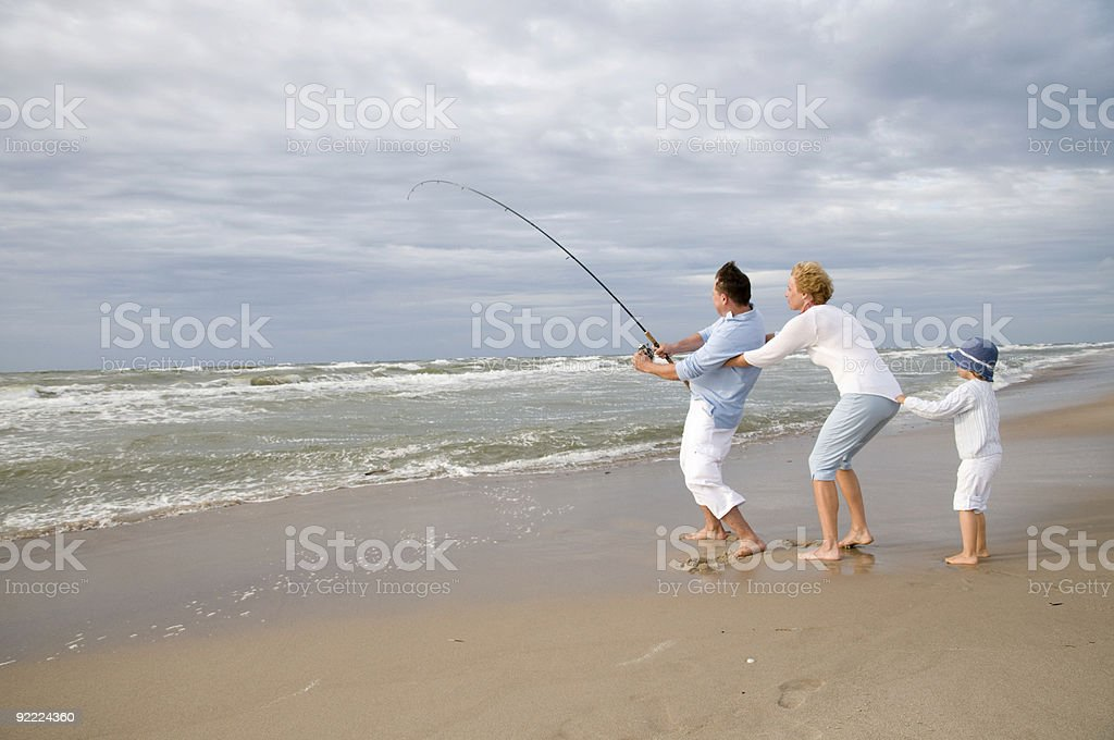 Happy family team big game fishing royalty-free stock photo