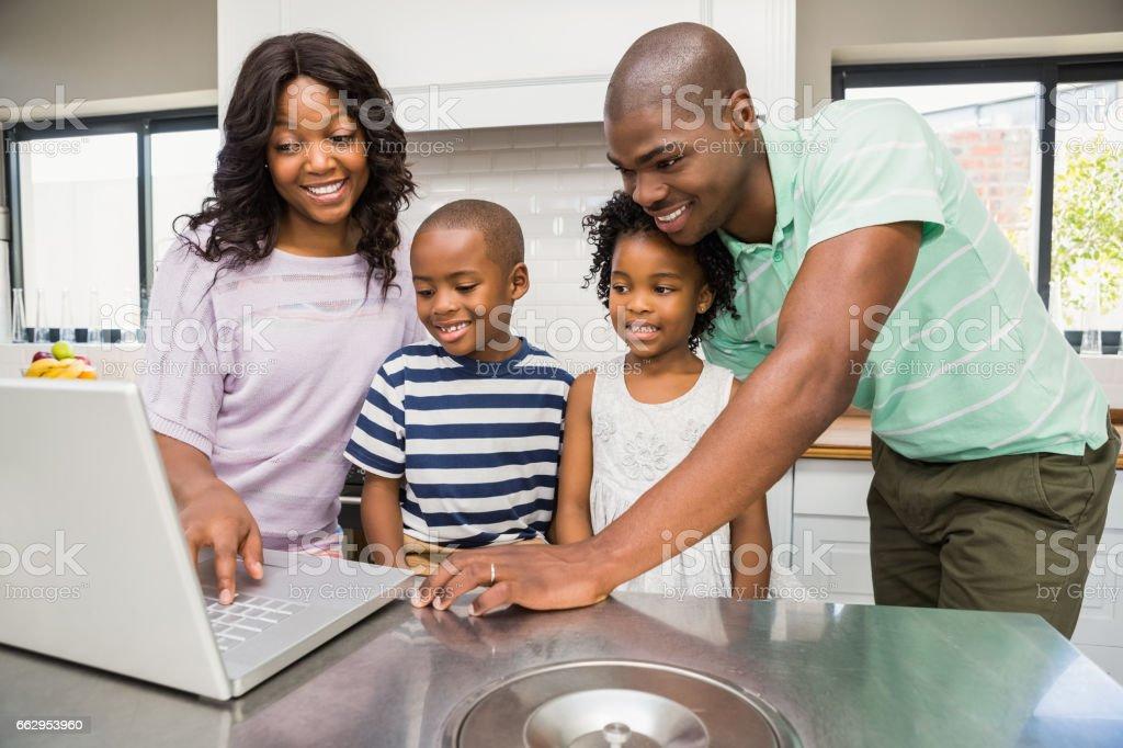 Happy family using laptop royalty-free stock photo