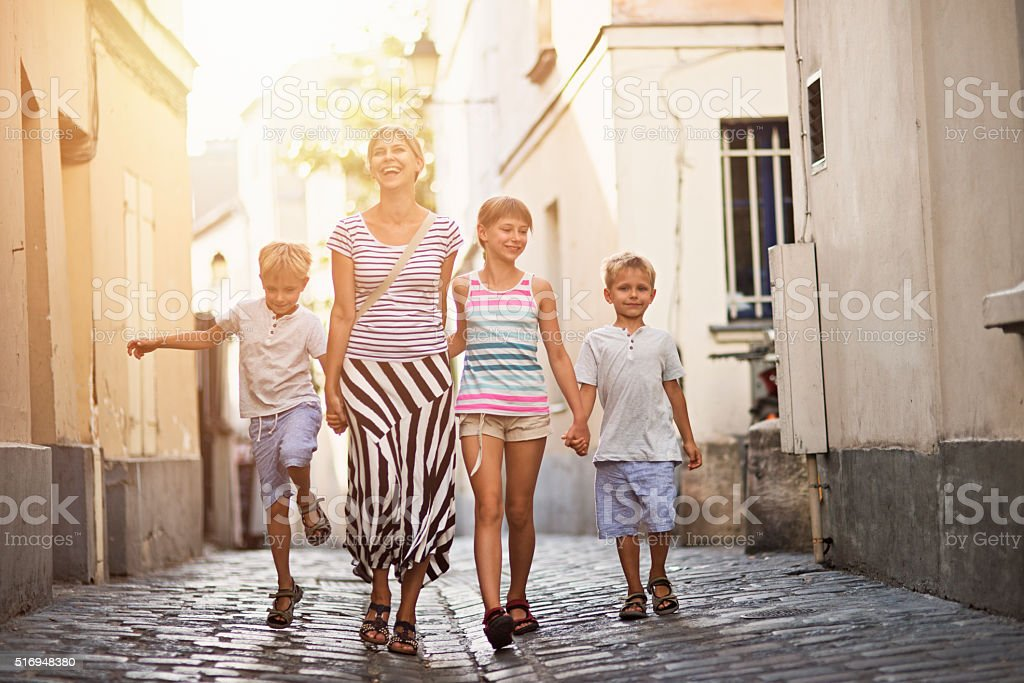 Happy family visiting Paris Montmartre stock photo