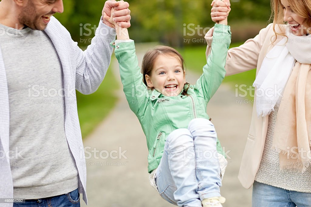 happy family walking in summer park and having fun stock photo