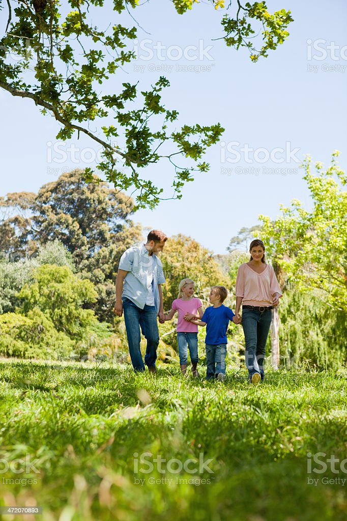 Happy family walking in the countryside royalty-free stock photo