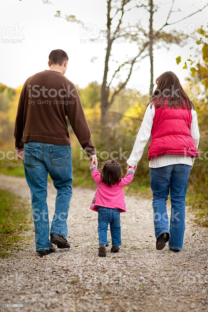 Happy Family Walking on Trail Through Autumn Woods royalty-free stock photo