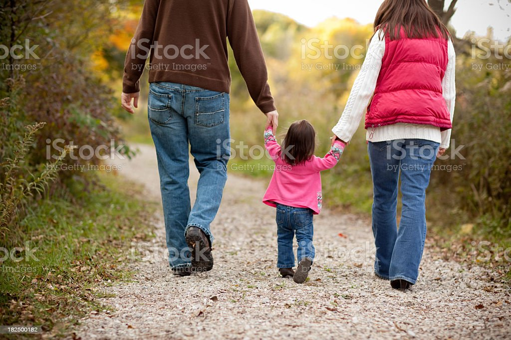 Happy Family Walking on Trail Through Autumn Woods royalty-free stock photo