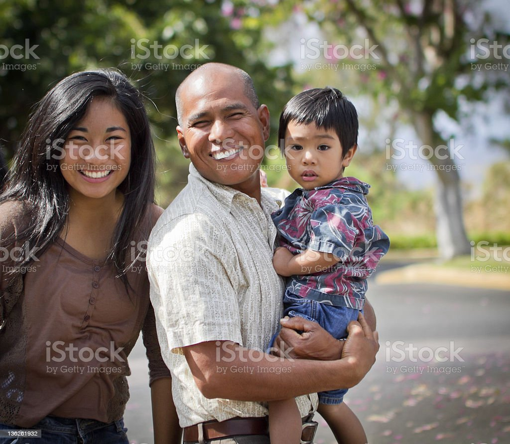 A happy family walking outdoors stock photo