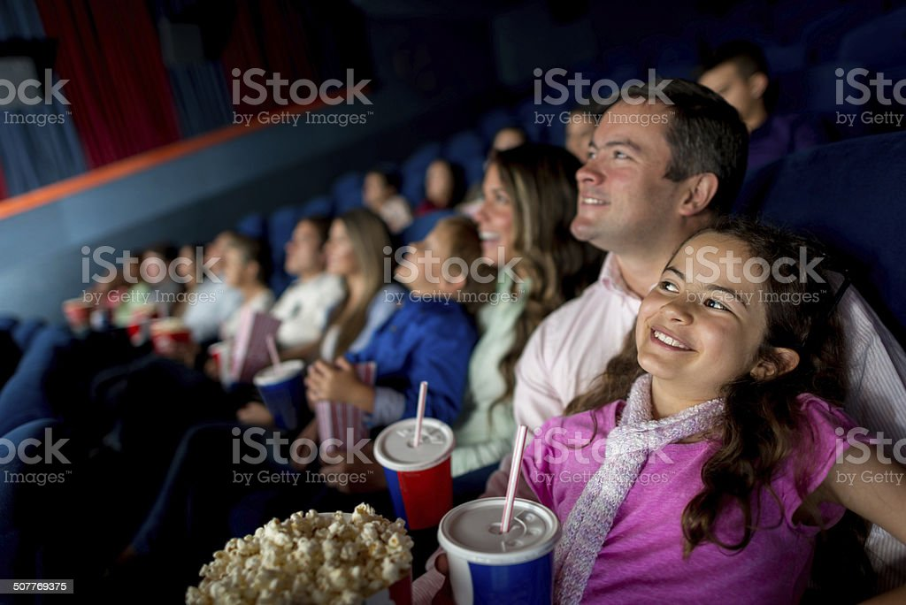 Happy family watching a movie stock photo