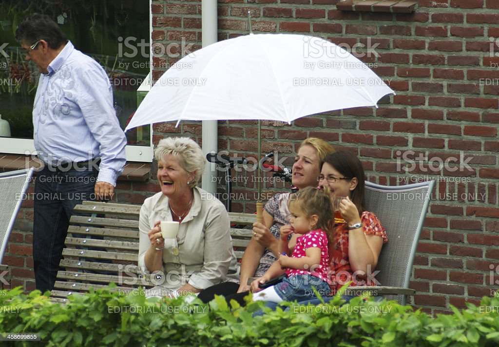 Happy family watching the street event royalty-free stock photo