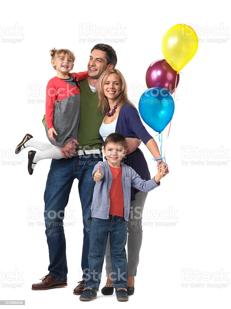 Happy family with a child holding 3 balloons royalty-free stock photo