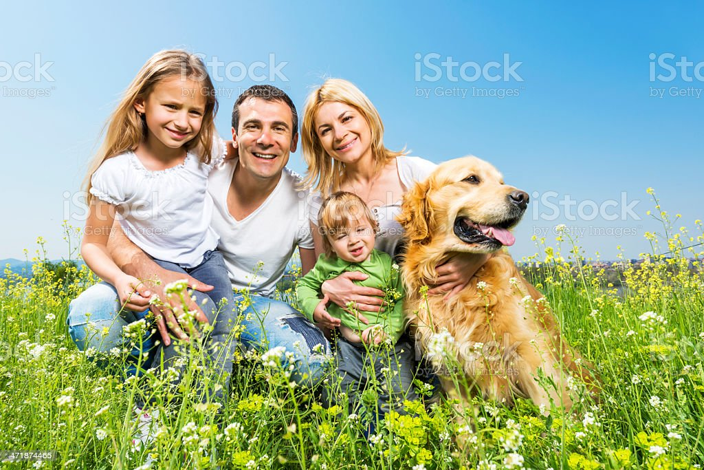 Happy family with a golden retriever. stock photo