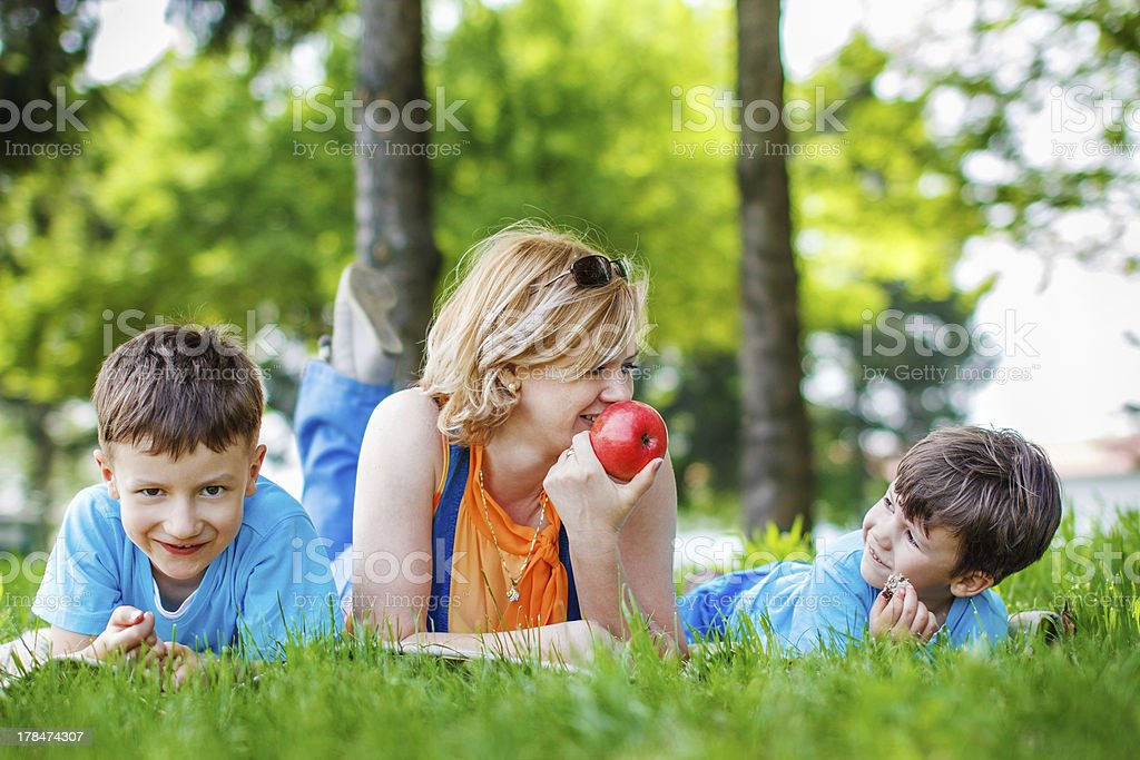 Happy family with apple royalty-free stock photo