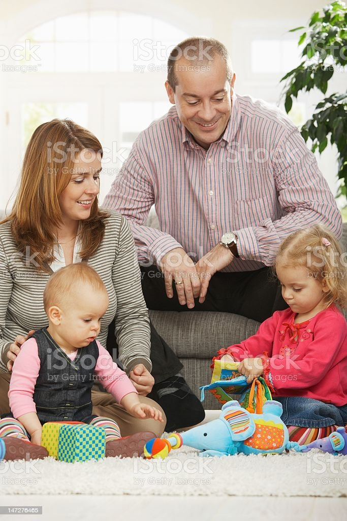 Happy family with baby and toddler royalty-free stock photo