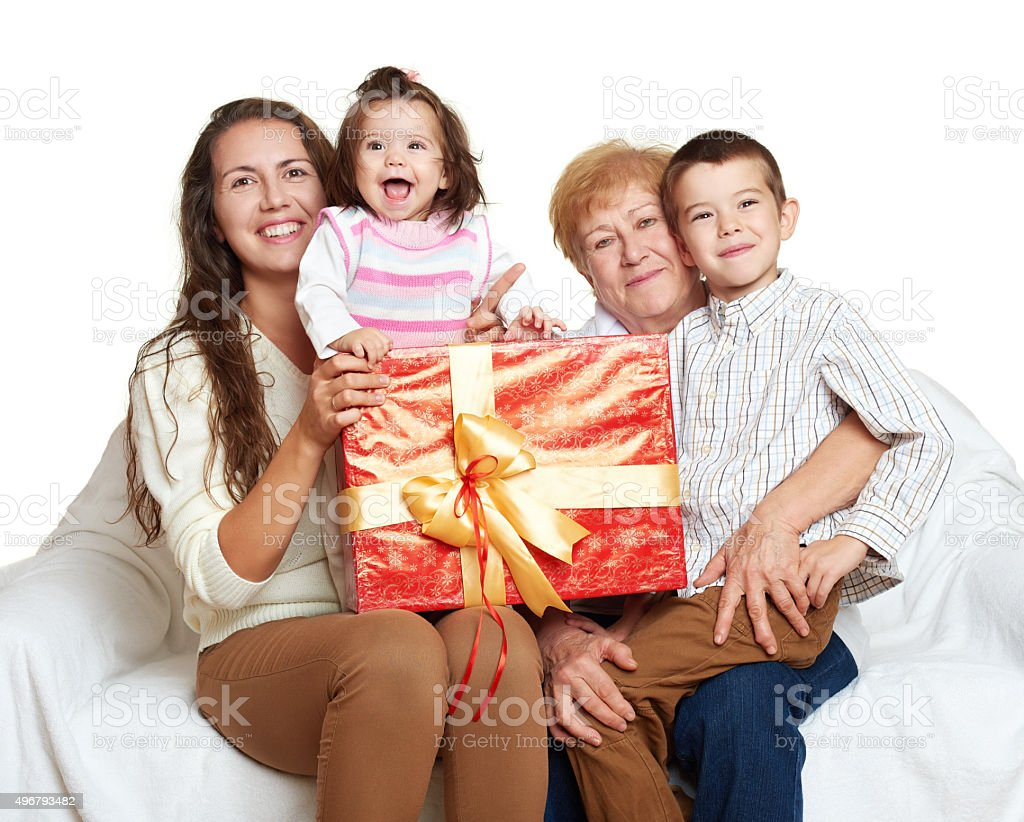 happy family with box gift, woman with child and senior stock photo