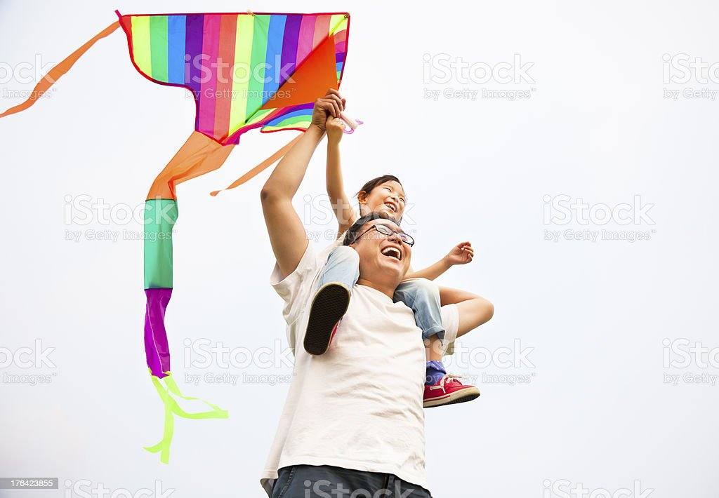 happy family with colorful kite royalty-free stock photo