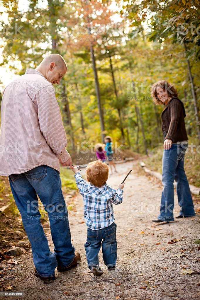 Happy Family with Father, Mother, and Son, in Woods royalty-free stock photo