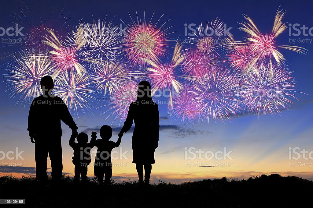 happy family with fireworks stock photo