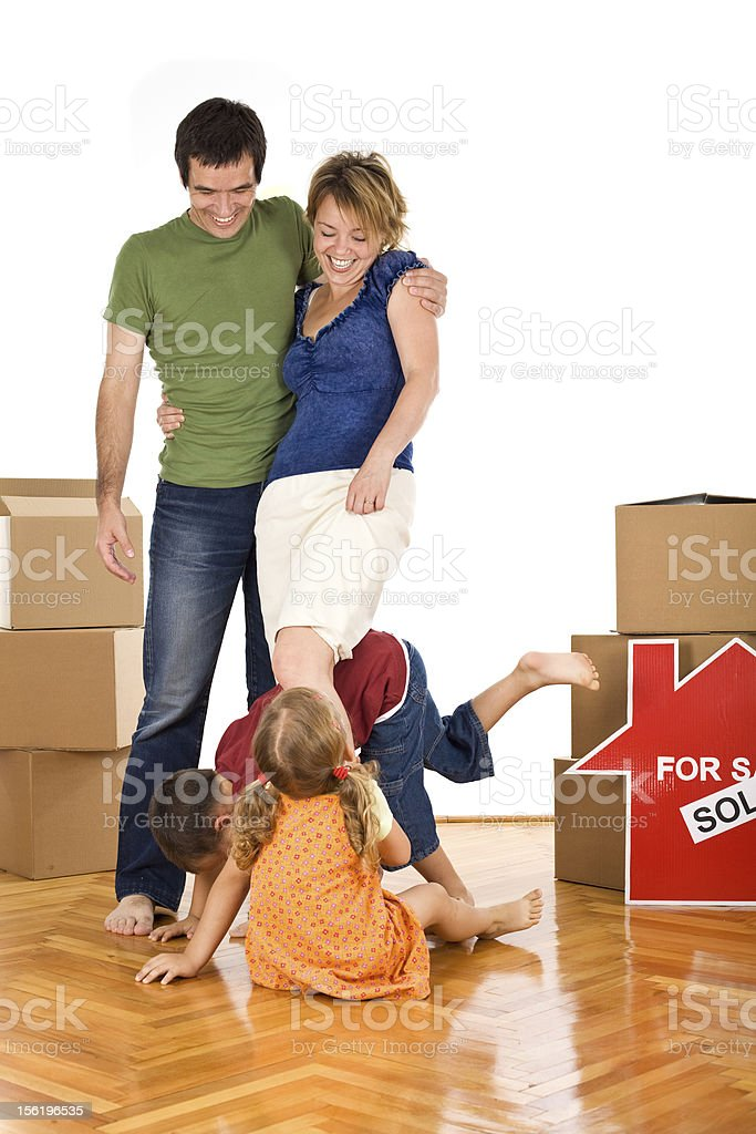 Happy family with kids in their new home royalty-free stock photo