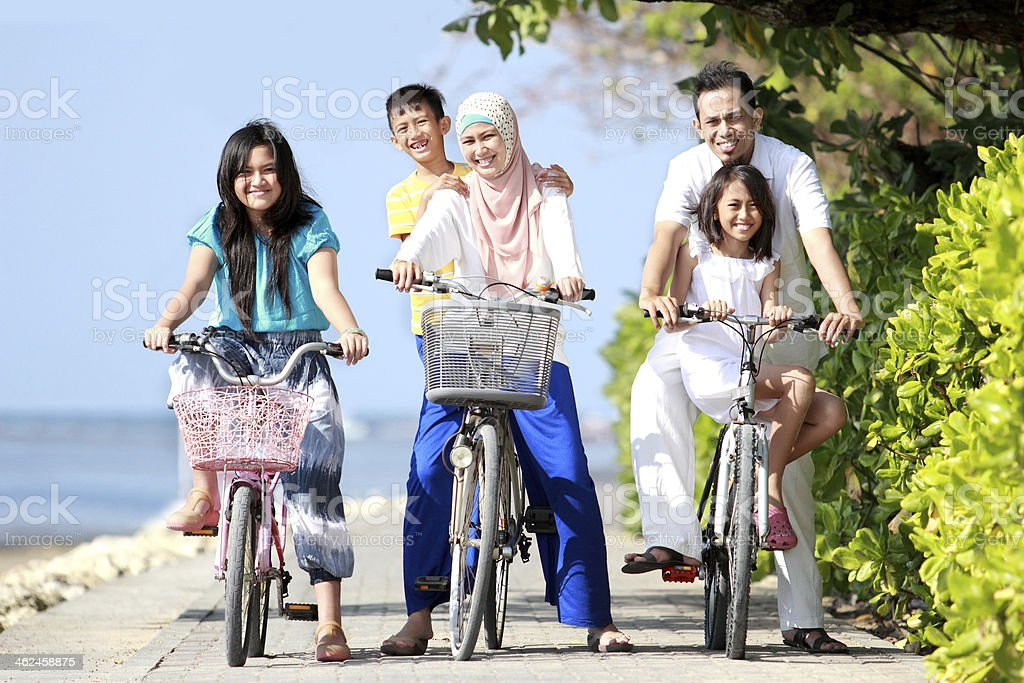 happy family with kids riding bikes royalty-free stock photo